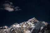 Mt. Everest and Lhotse beneath a star filled night sky