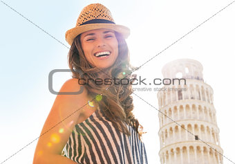 Portrait of smiling young woman in front of leaning tower of pis