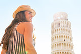 Happy young woman in front of leaning tower of pisa, tuscany, it