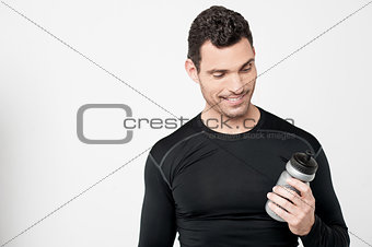 Fitness man looking his sipper bottle