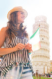 Young woman with italian flag in front of leaning tower of pisa,