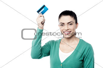 Attractive woman holding up cash card
