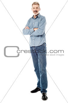 Matured man posing with folded hands