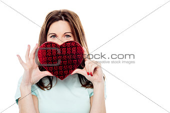 Attractive woman with gift box in form of heart