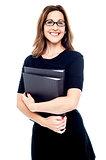 Smiling women holding folder in hand
