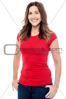 Beautiful woman posing with hands in pockets