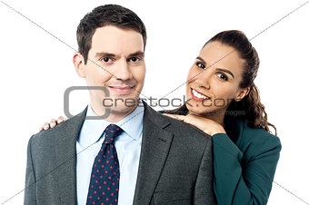 Attractive business couple posing together