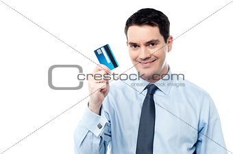 Corporate man holding debit card