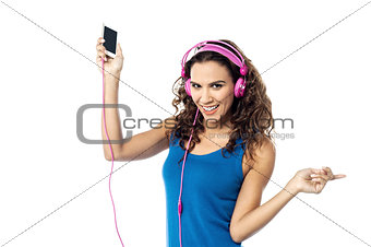 Preety woman listening to the music from smart phone