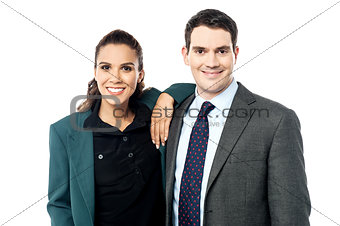Smiling business couple posing together