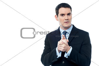 Calm businessman with clasped hands