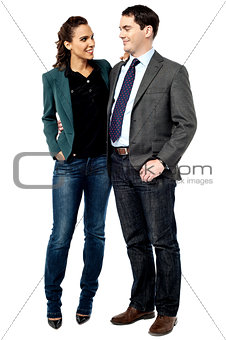 Businessman and woman talking together