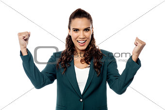 Business woman cheering with her arms raised
