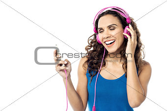 Beautiful woman listening music on her cell phone