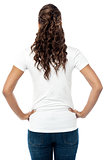 Back pose of stylish young woman