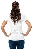 Back pose of stylish young woman