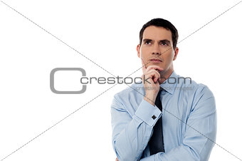 Thoughtful middle aged business man looking up