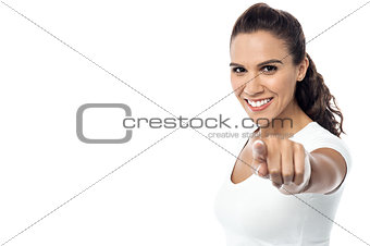 Attractive young woman pointing you out