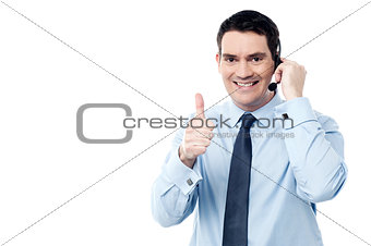 Call center agent showing thumb up
