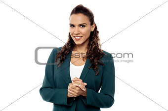 Attractive woman with clasped hands