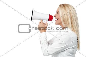 Corporate woman talking over mega phone