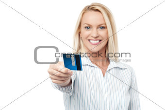 Smart executive woman holding credit card