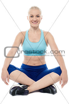 Athletic woman sitting and resting