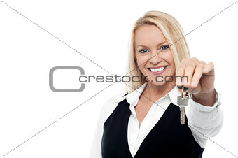 Attractive smiling woman holding a key