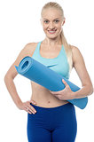 Fitness woman with an excercise mat