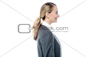 Business woman posing sideways