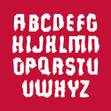 Uppercase calligraphic brush letters isolated on red background,