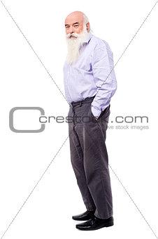 Old man posing to camera, full length.