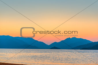 beautiful sunrise over the mountains over the sea
