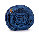 roll of blue jeans on a white background