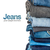 Stack of blue and black jeans as a background