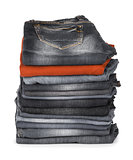 stack of jeans brown and black on a white background