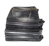 stack of jeans gray and black on a white background