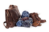 set consisting of jeans belt and bag on a white background