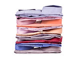 Stacks of many colored clothes isolated on a white background