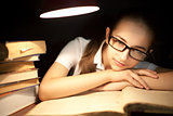 Young girl bored at reading