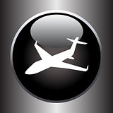 Plane silhouette on black button
