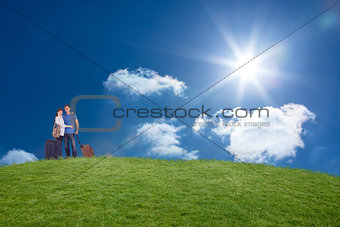 Composite image of happy couple going on holiday