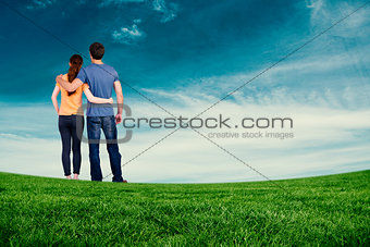 Composite image of couple with backs to camera