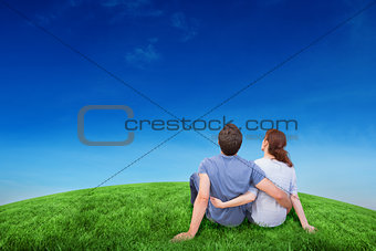 Composite image of couple sitting on floor together