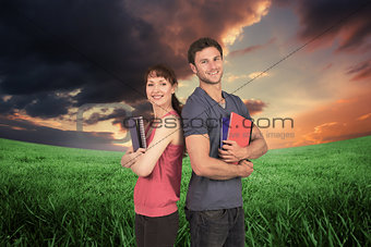 Composite image of two students both with notepads