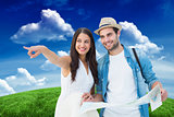 Composite image of happy hipster couple looking at map