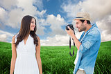 Composite image of handsome hipster taking a photo of pretty girlfriend