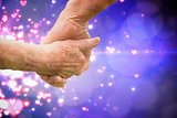 Composite image of elderly couple holding hands