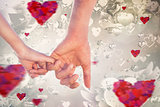Composite image of loving young couple holding hands