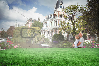Composite image of happy couple smiling and embracing